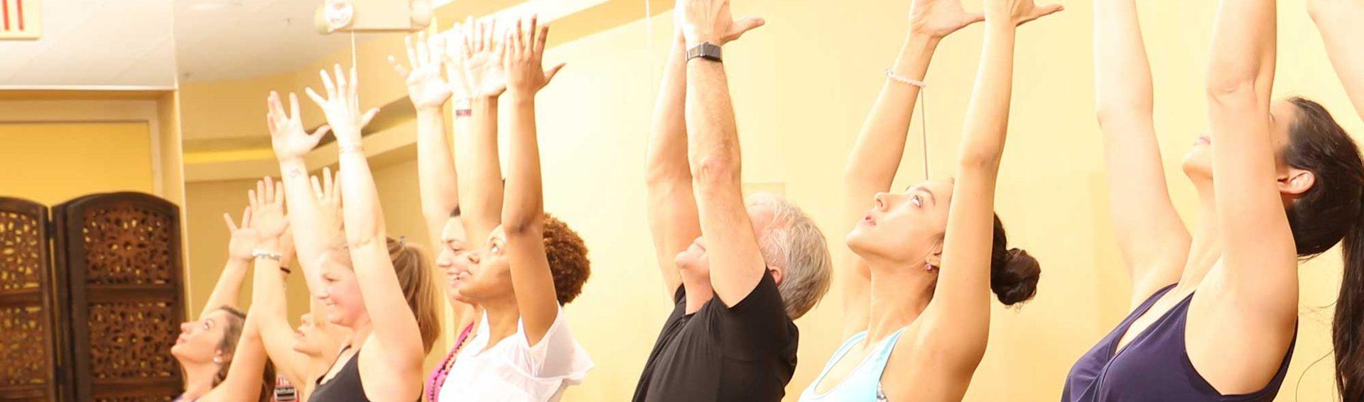 Yoga class, arms raised