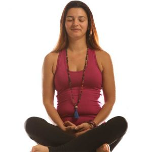Woman sitting in a meditative pose
