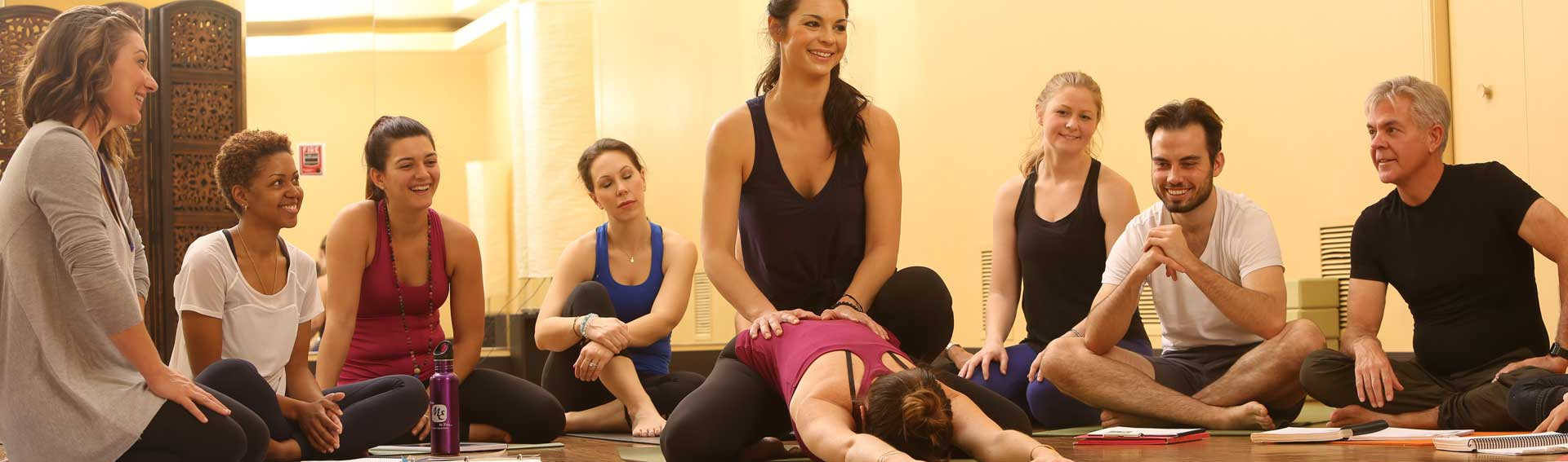 Yoga class learning from instructor